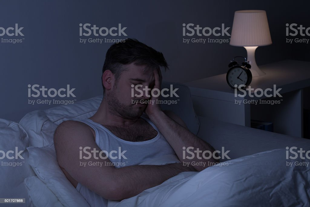 Tired man needs some sleep stock photo