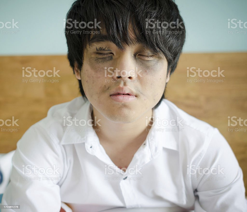 Tired man waking up in the morning royalty-free stock photo