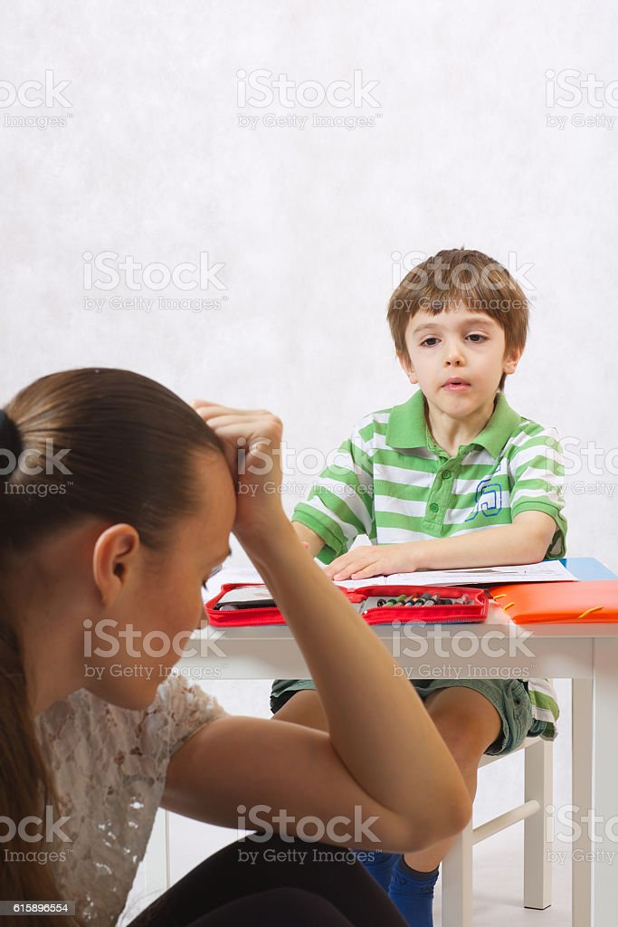 Tired mother and a six years old child stock photo