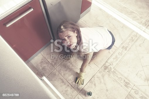 tired of cleaning the dirty kitchen floor stock photo 652549788