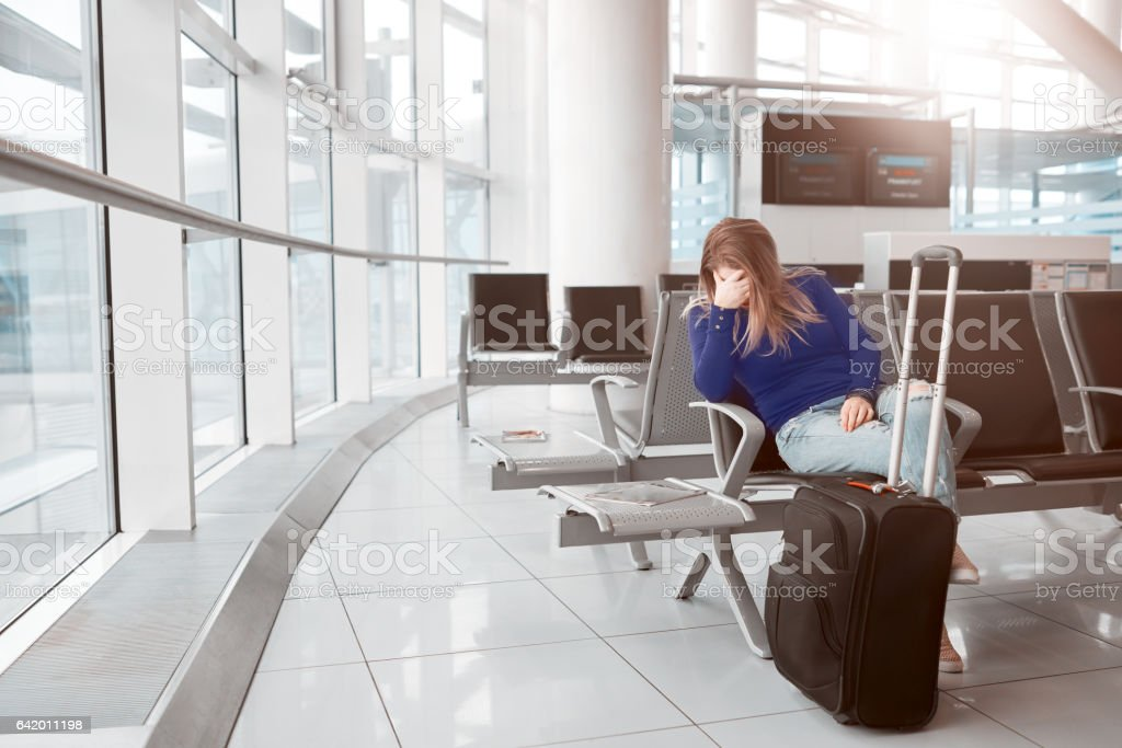tired of waiting inside airport lounge stock photo