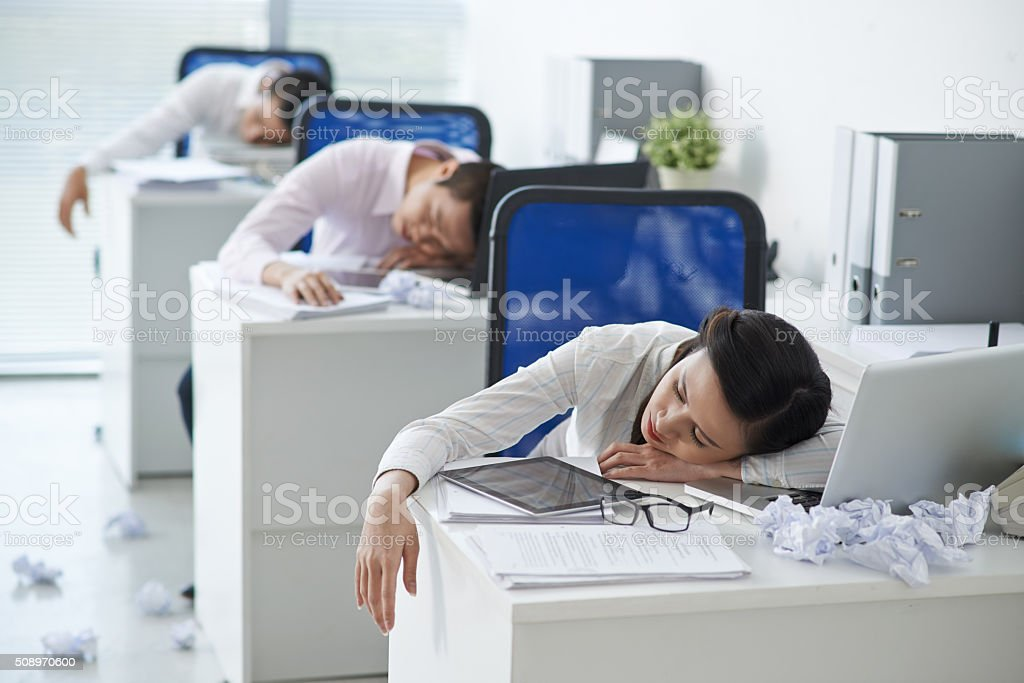Tired office workers stock photo