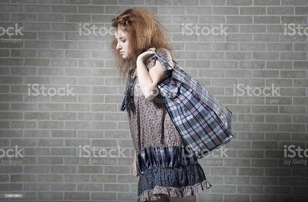 Tired redhaired woman with shopping bag royalty-free stock photo