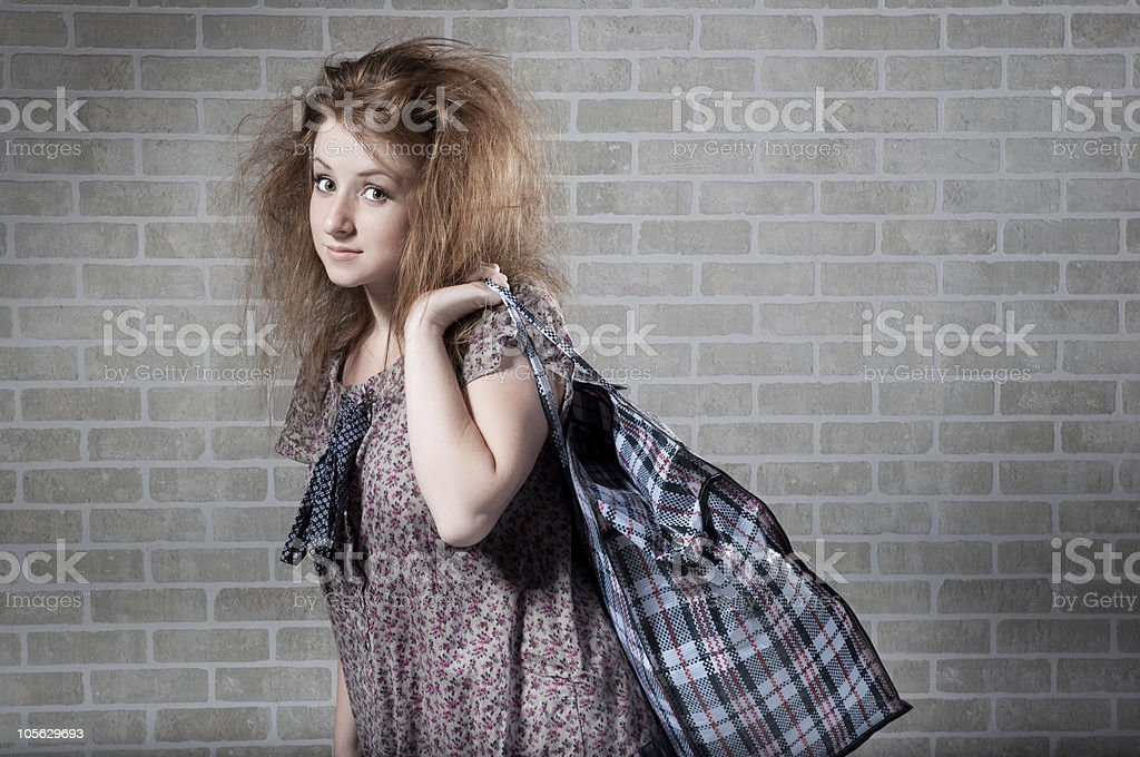 Tired redhaired woman with shopping bag. royalty-free stock photo