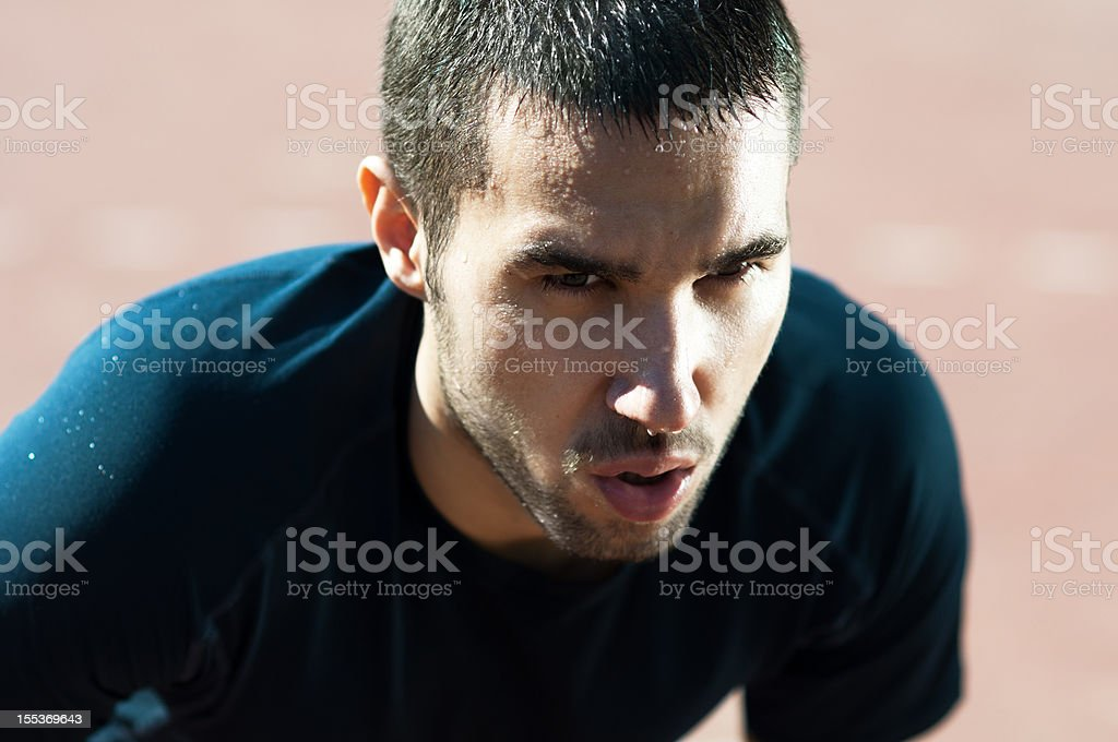 tired runner taking break stock photo
