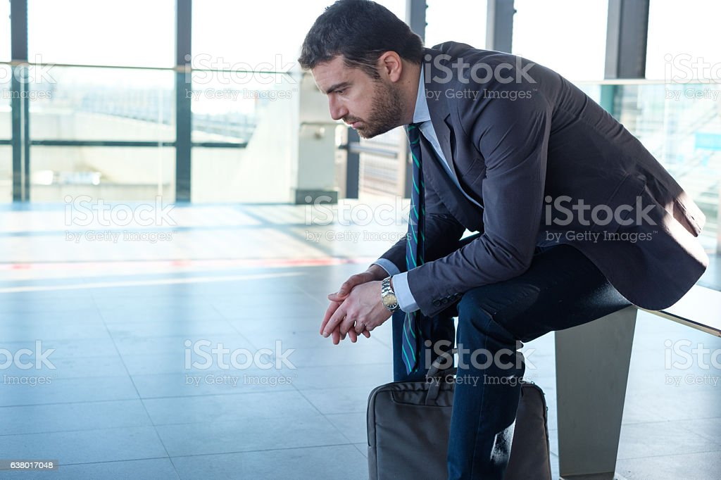 Tired sad businessman commuter is traveling stock photo
