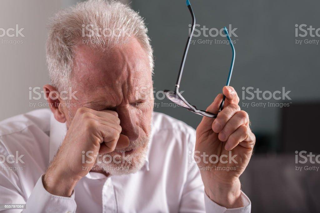 Tired senior businessman stock photo
