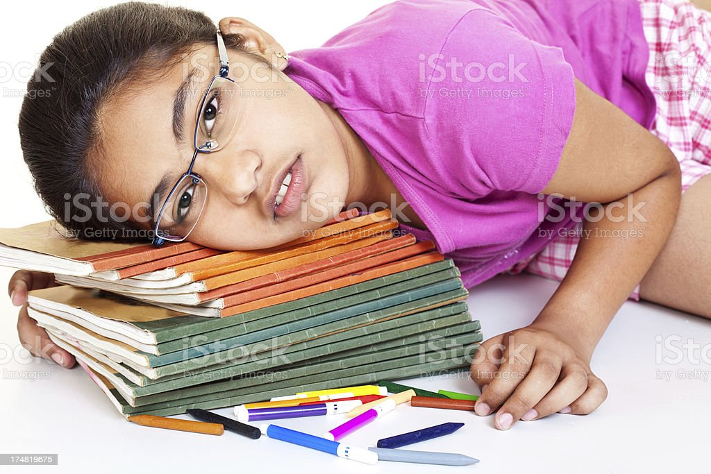 Tired Sleepy Indian Teenager Girl Student with her School Books royalty-free stock photo