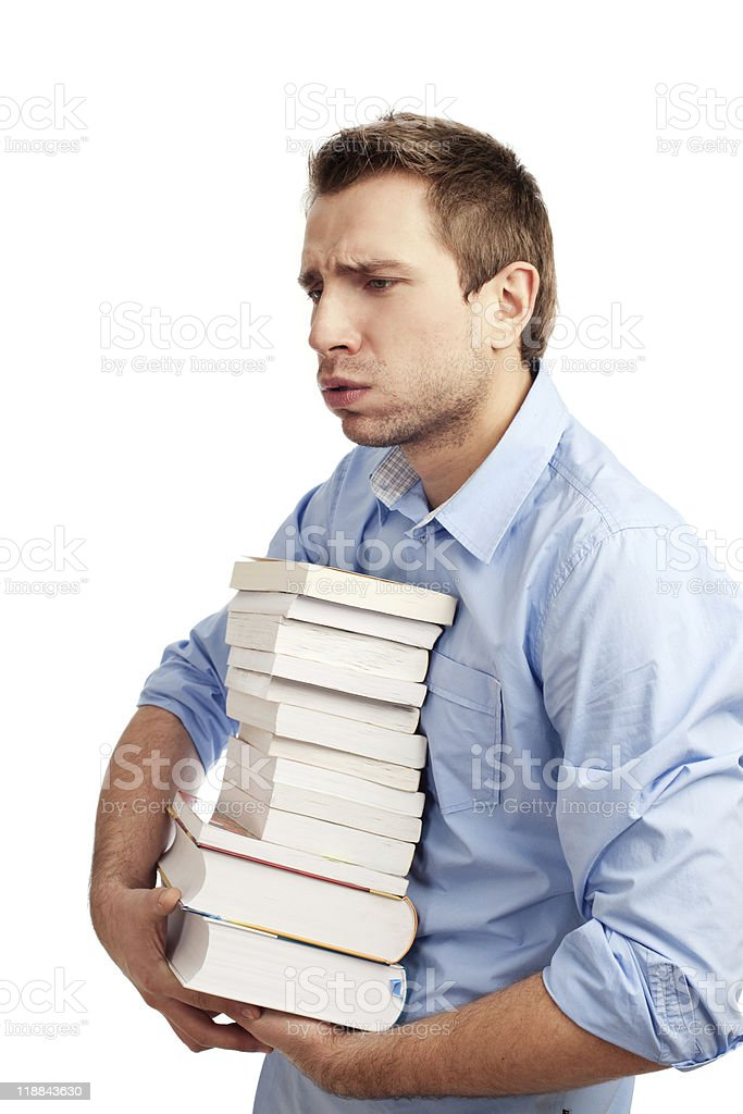 Tired student holding books royalty-free stock photo