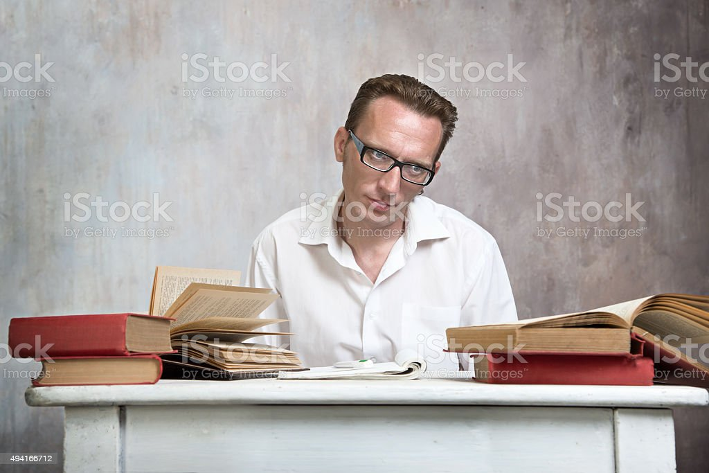 tired student work with books stock photo