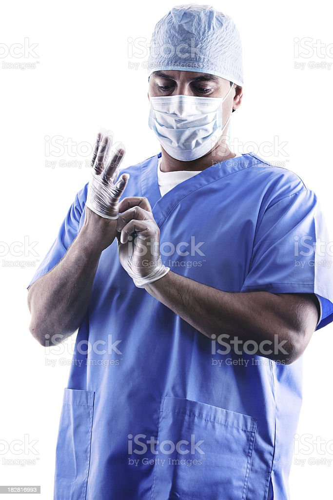 Tired surgeon removing gloves after surgery royalty-free stock photo