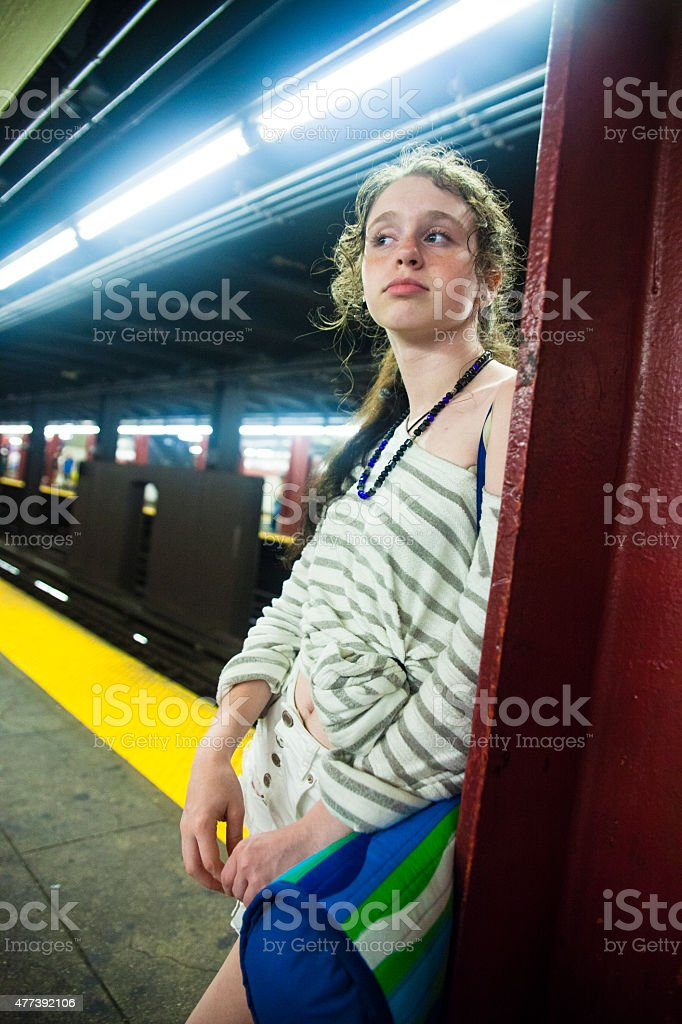 Tired teenager girl at the subway station stock photo