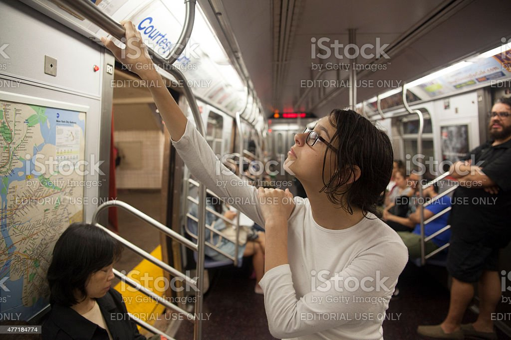 Tired teenager girl in the subway car stock photo