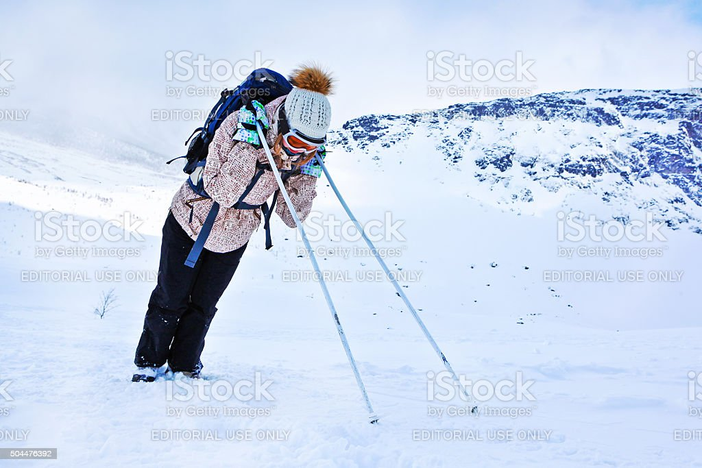 Tired tourist resting during a winter hiking on Khibiny mountain stock photo