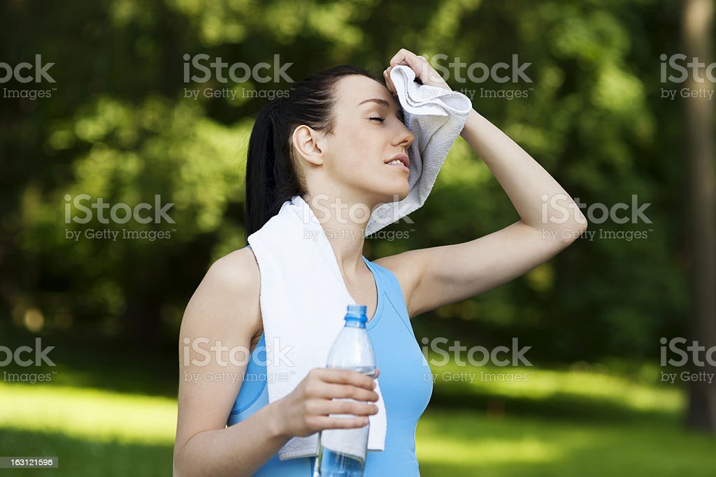 Tired woman after jogging royalty-free stock photo