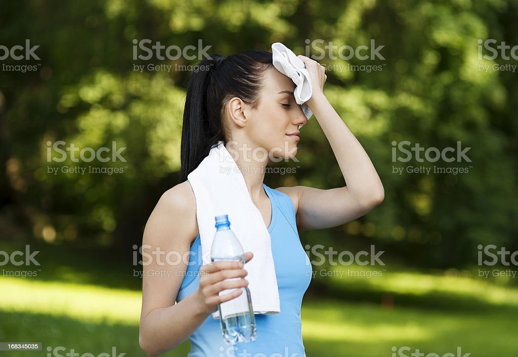 Tired woman after jogging stock photo
