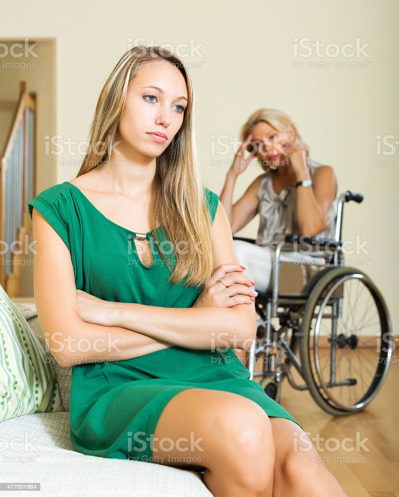 Tired woman and disabled person stock photo