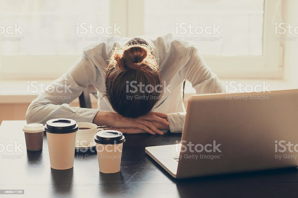 Tired woman in the office stock photo