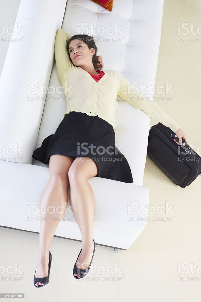 Tired Woman Lying On Sofa After Returning From Work royalty-free stock photo