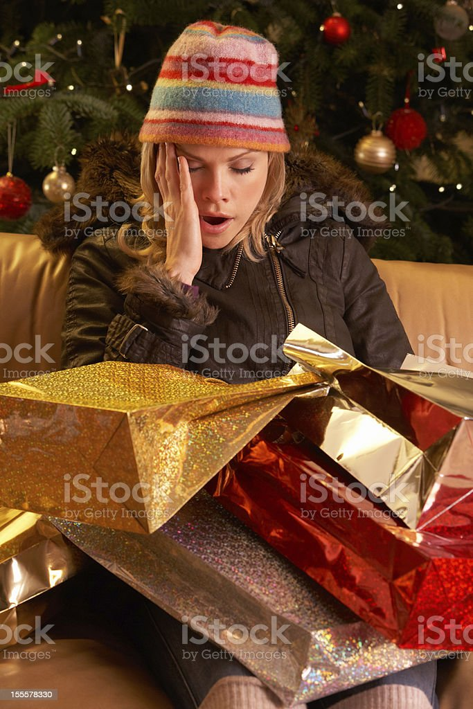 Tired Woman Returning After Christmas Shopping Trip royalty-free stock photo