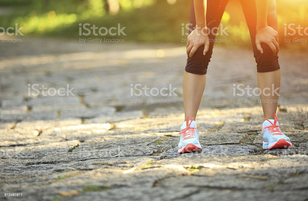 tired woman runner  have a rest after running hard stock photo