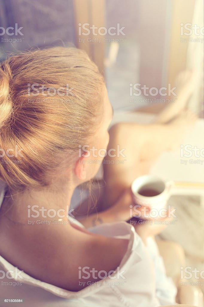tired woman takes a break in her home stock photo