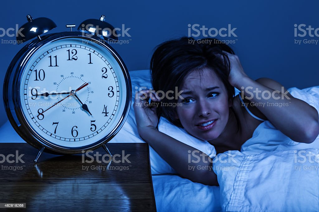 Tired Woman Waking Up on Monday Morning stock photo