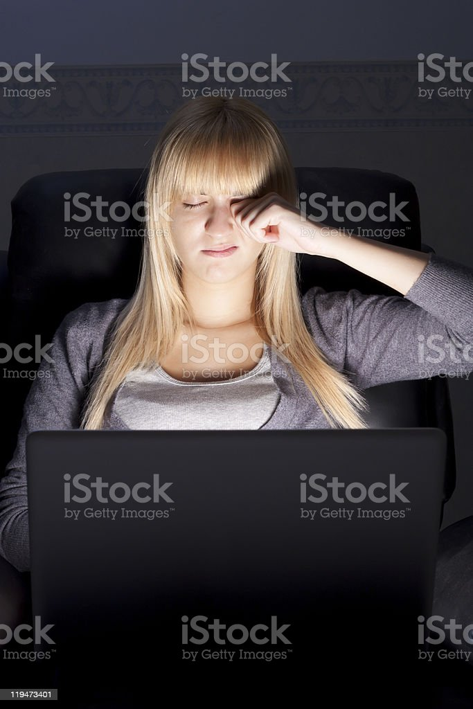 Tired Woman with Laptop stock photo