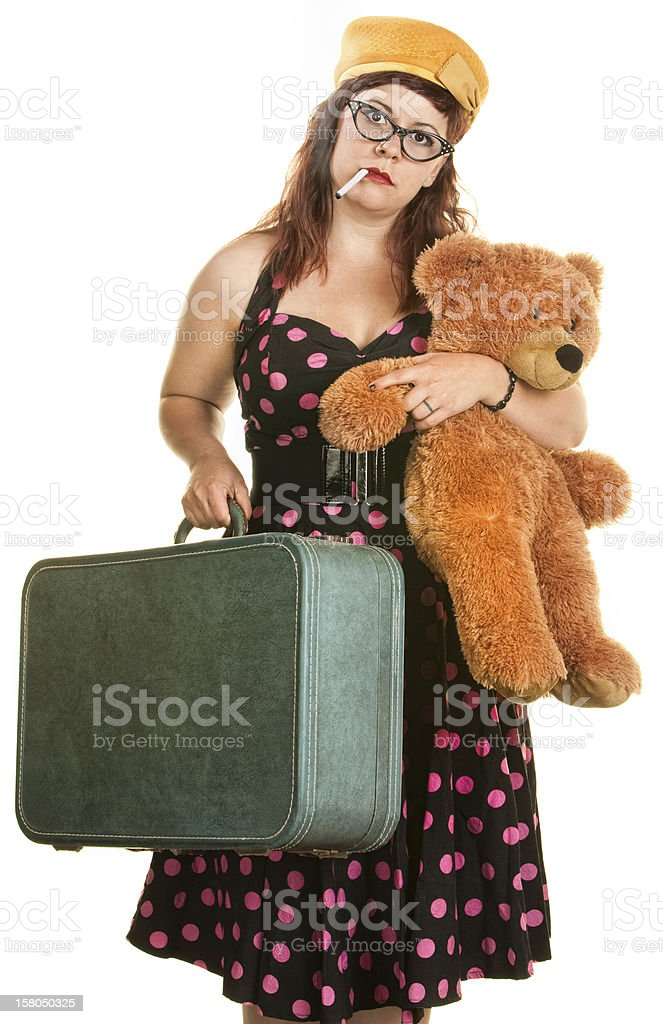 Tired Woman with Suitcase and Toy stock photo