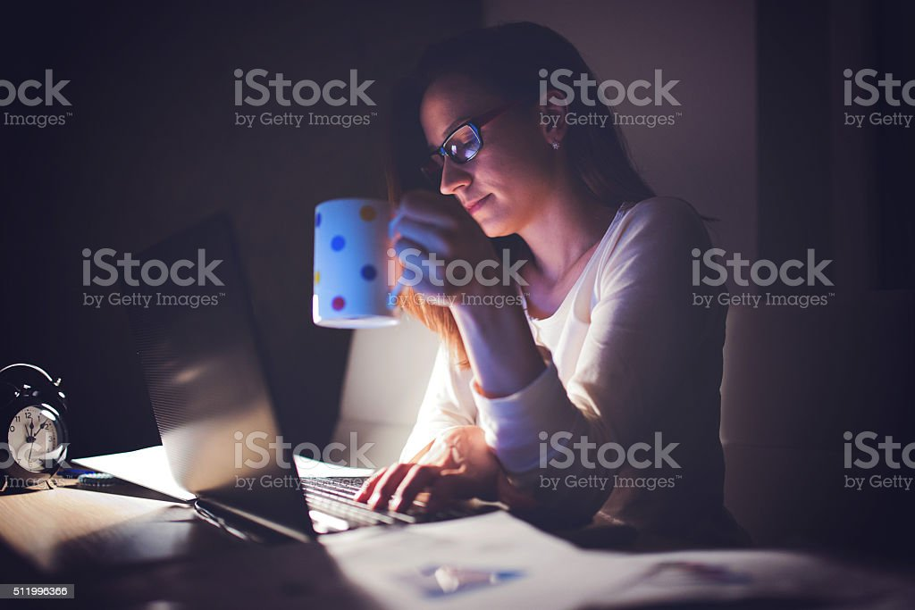 Tired Woman working at home,making a break stock photo
