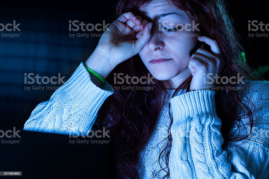 Tired Woman Working with a Computer stock photo