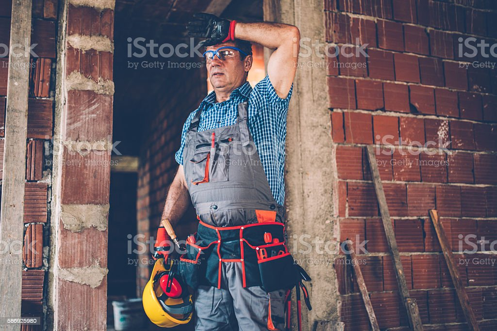 Tired Worker with tool stock photo
