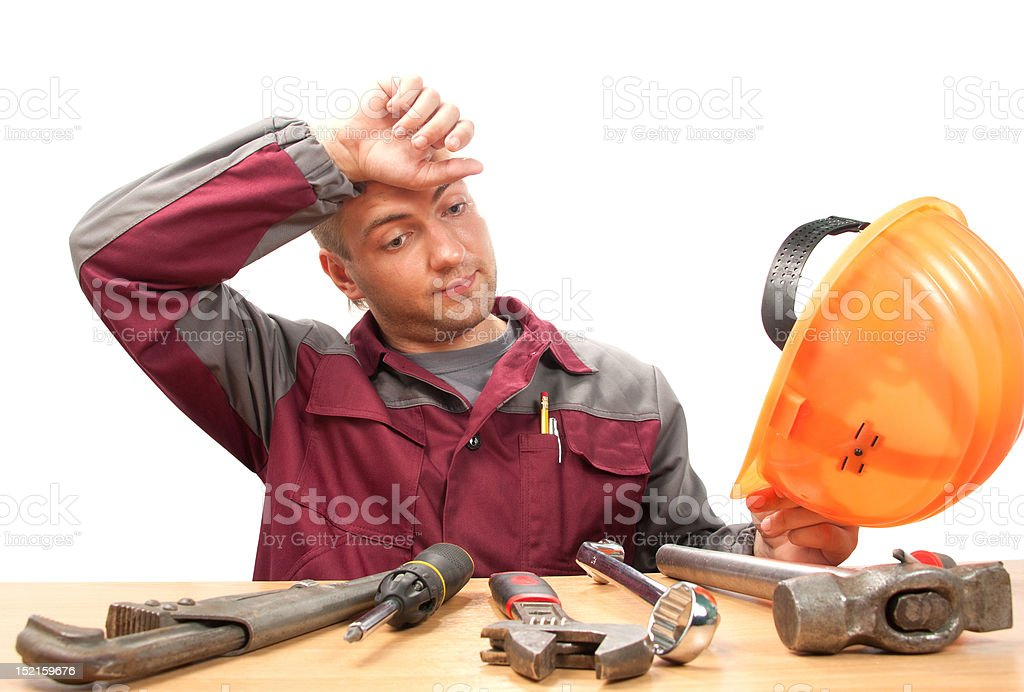 Tired working man with tools royalty-free stock photo