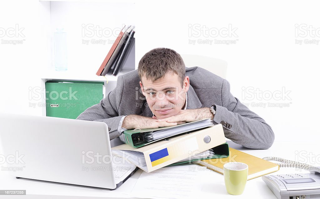 Tired young and handsome businessman royalty-free stock photo