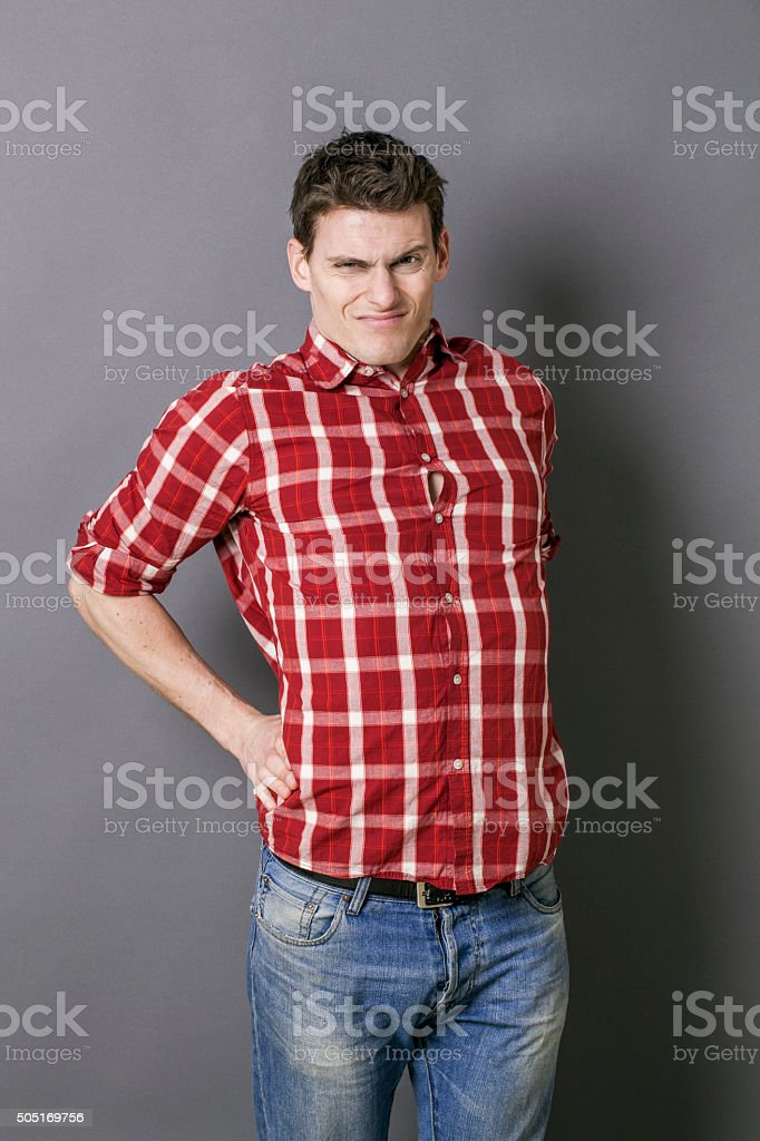 tired young athletic man stretching, relaxing tension in spine stock photo