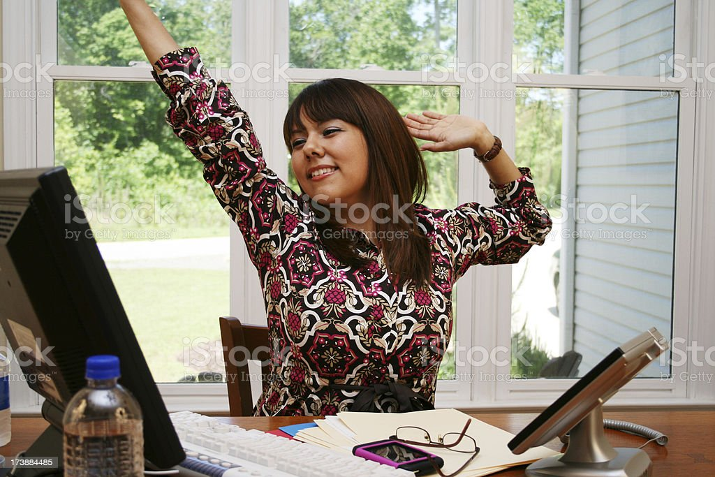 Tired Young Hispanic Woman At Work royalty-free stock photo