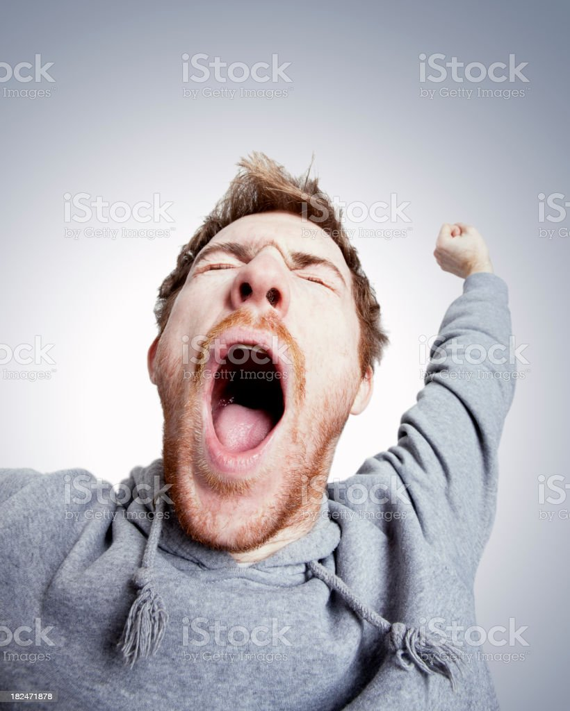 Tired Young Man Stretching and Yawning with Open Mouth stock photo