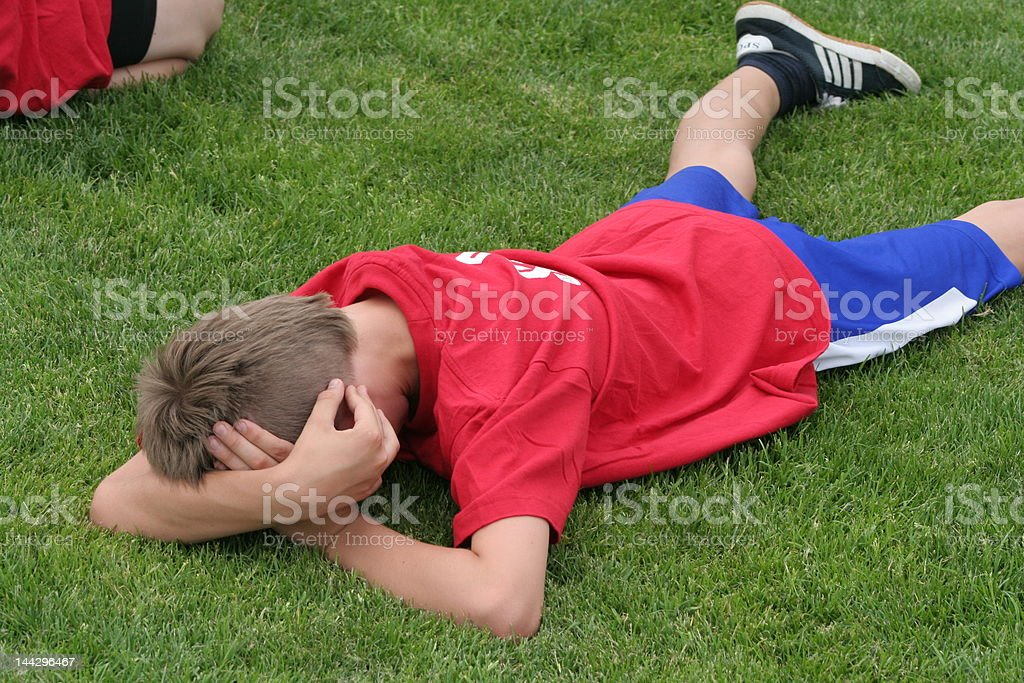 Tired young sportman stock photo