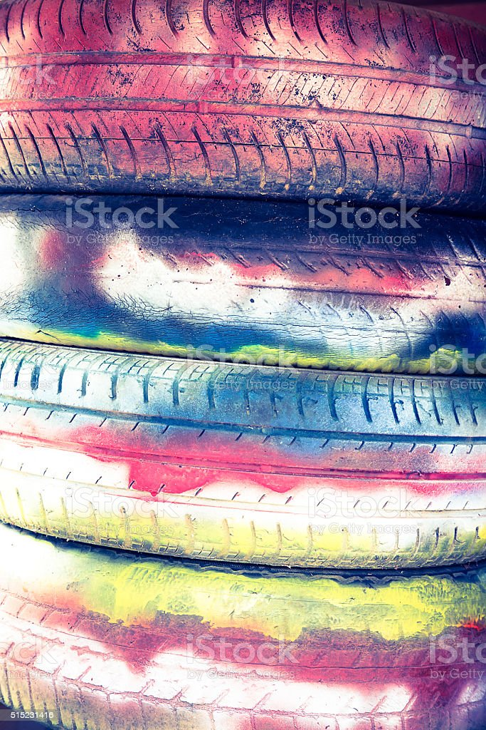 Tires are painted with colored paints for background stock photo