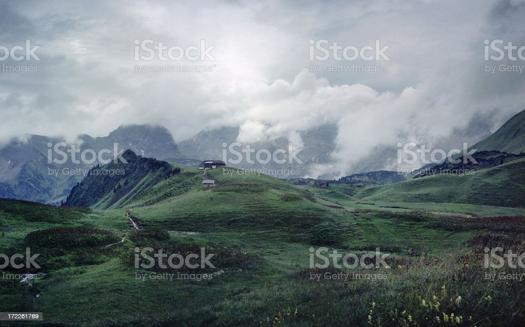 Tirolean Alps Landscape with Mountain Hut and Clouds royalty-free stock photo