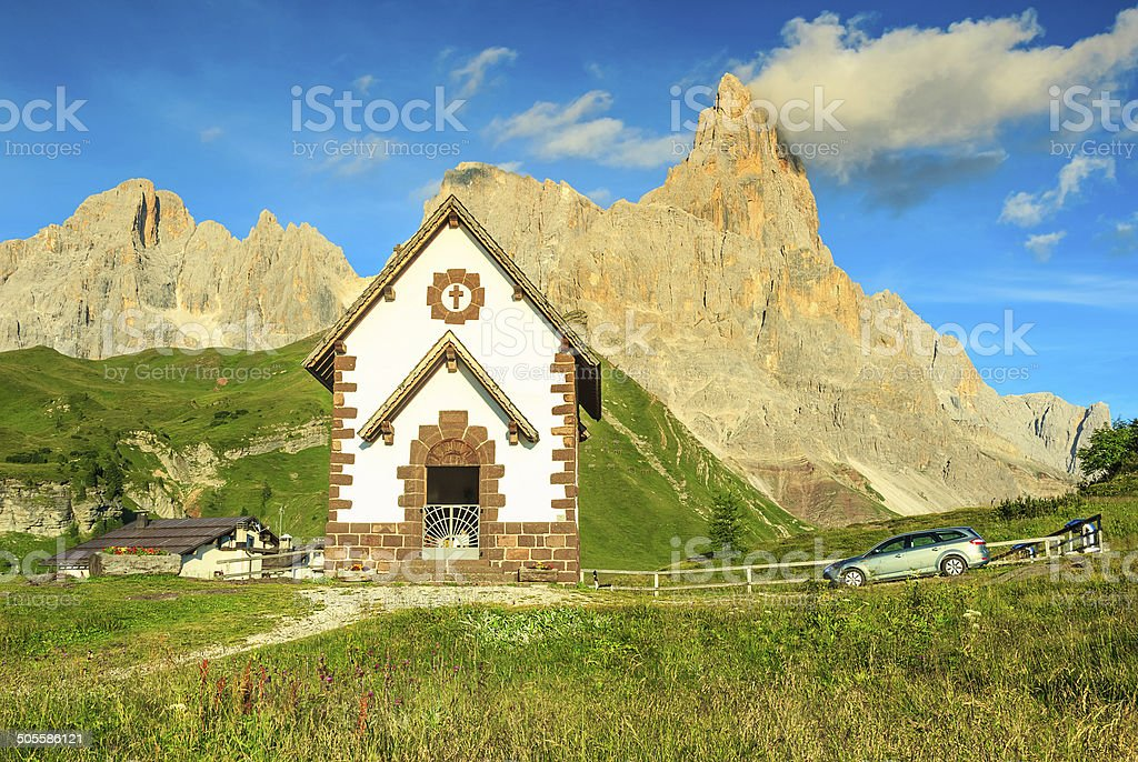 Tirolian chapel,car and high mountains,Dolomites,Italy,Europe stock photo