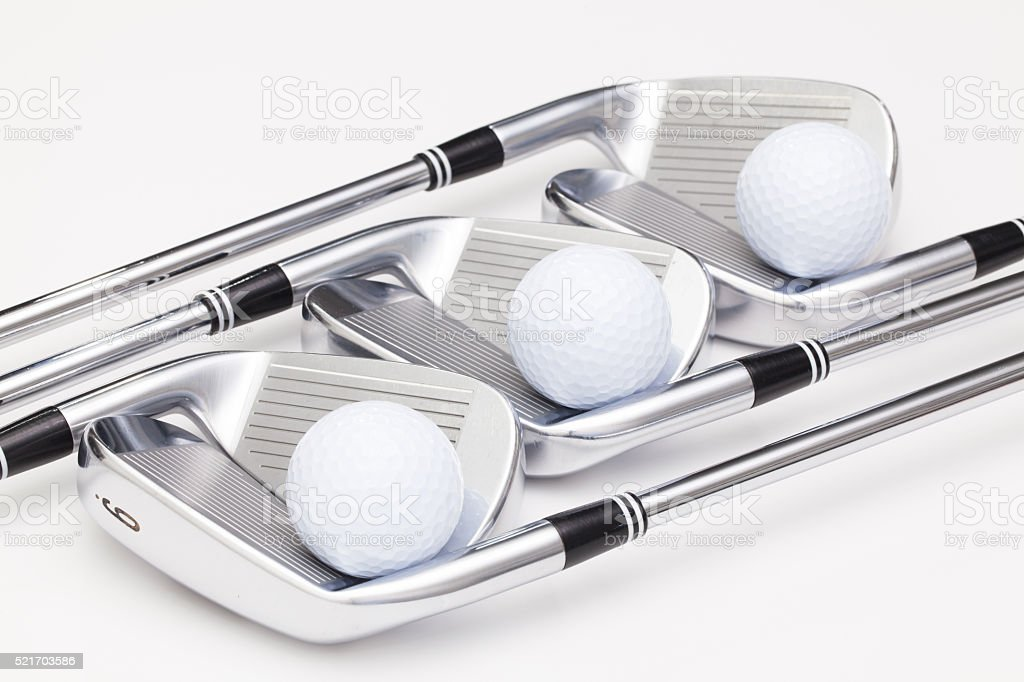 Titanium golf clubs on the white table stock photo