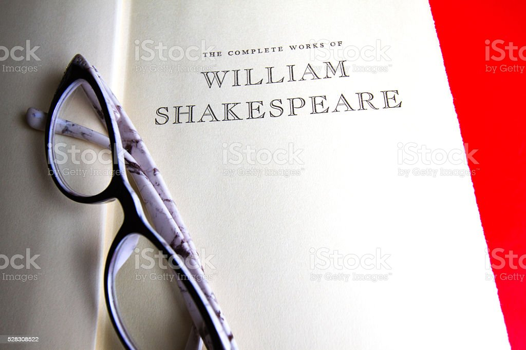 Title Page: 'The Complete Works of William Shakespeare'; Glasses stock photo