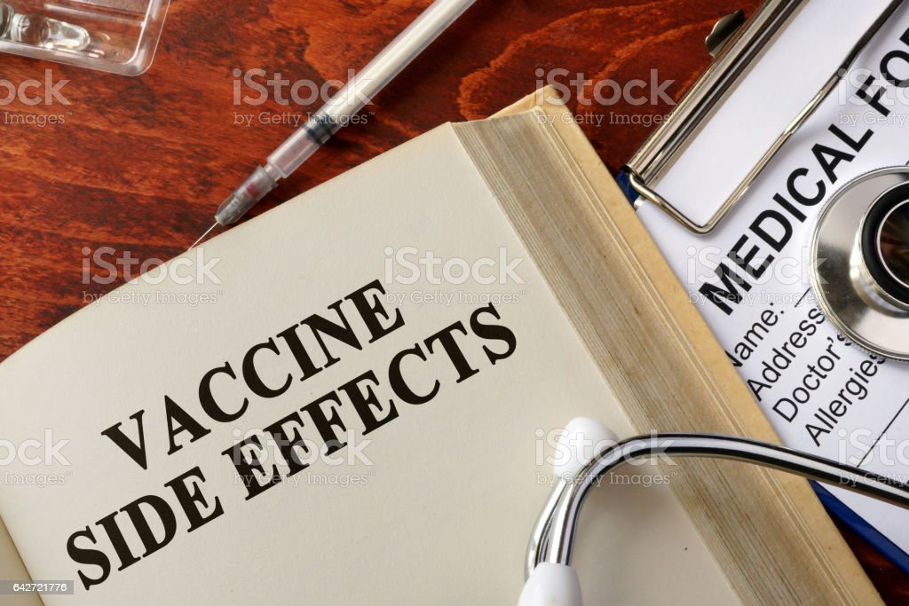 Title vaccine side effects on a book. stock photo