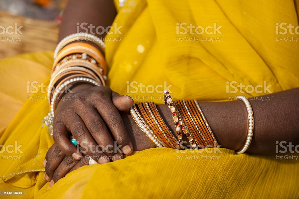 TitleWrinkled indian woman hands stock photo