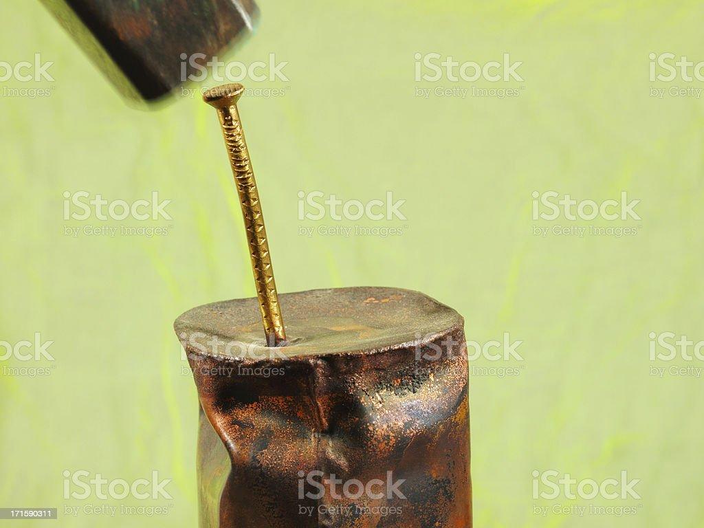 to bang in a nail stock photo