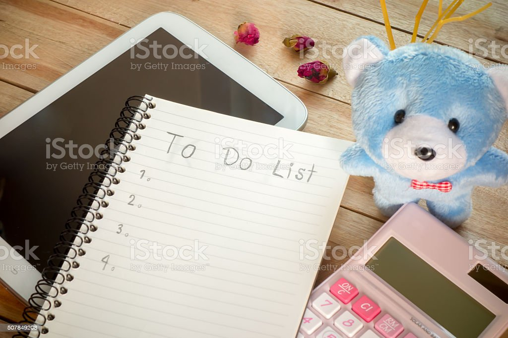 To do list notebook with tablet calculator pencil on wooden stock photo