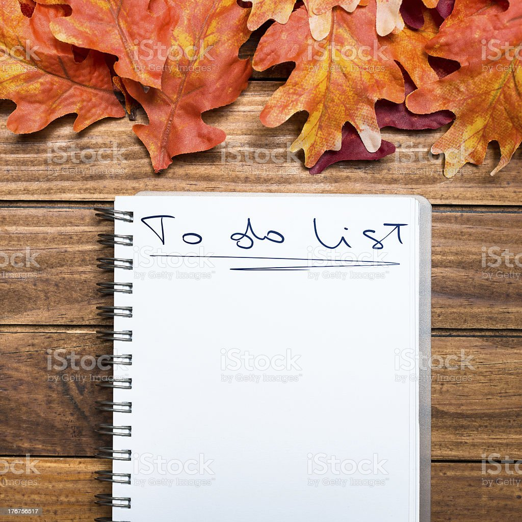 To do List on Autumn leaves background royalty-free stock photo
