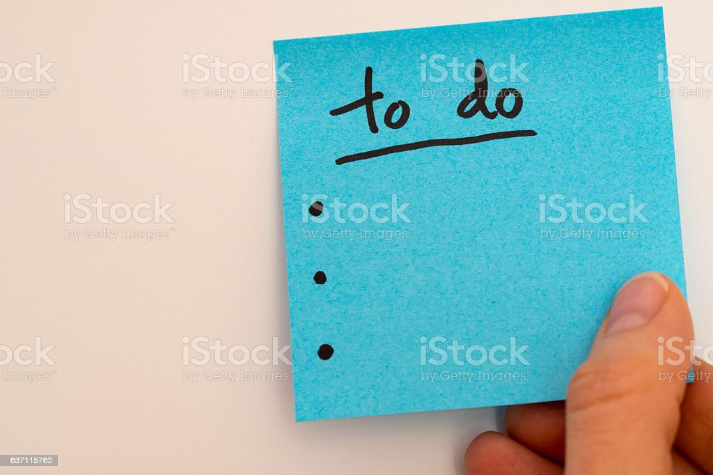 to do list with a hand stock photo