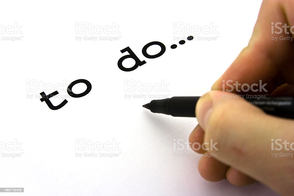 To Do List with Hand and Pen royalty-free stock photo